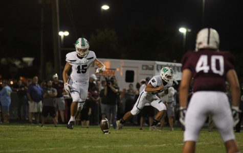 Junior Ian Williams kicks the ball back to the Spartans after the Warriors make a touchdown.