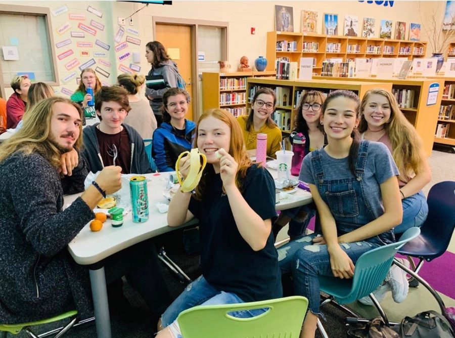 A+group+of+seniors+sit+in+the+media+center+and+enjoy+their+exclusive+senior+food.+The+first+senior+breakfast+was+held+Friday+September+20th+to+great+fanfare.+Image+courtesy+the+WHS+Senior+Instagram+page.