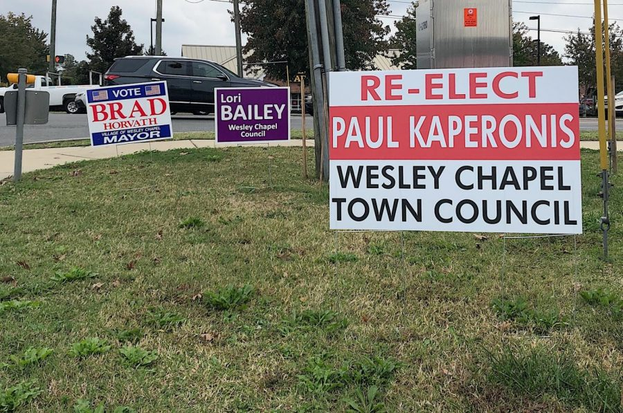 Signs+were+placed+weeks+before+the+Wesley+Chapel+election+in+front+of+a+busy+intersections+to+remind+the+residents+of+Wesley+Chapel+to+vote.