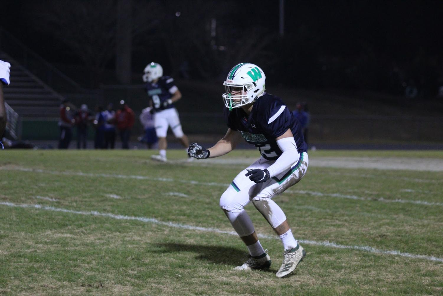 Senior Dusty Mercer stands ready while on offense against Parkland during the second round of the playoffs. His efforts along with the rest of the offensive line are what enabled Weddington to have such a stellar season.