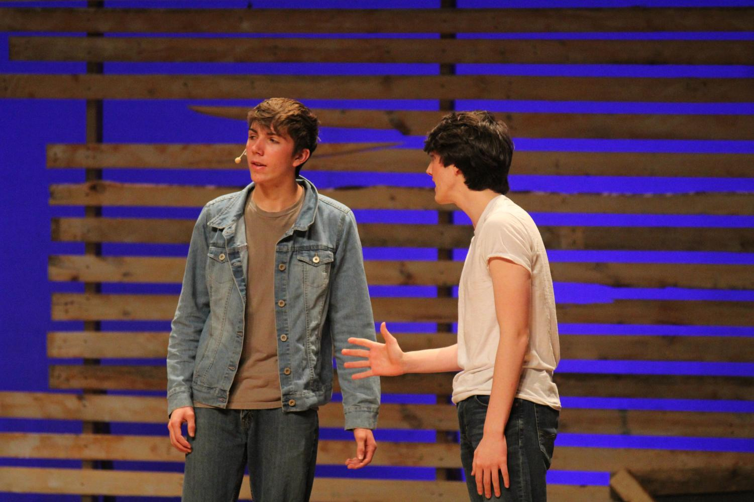 Ponyboy, played by Andrew Page. talks with his good friend Johnny, played by Colin Pendergrast, about the building tension between the