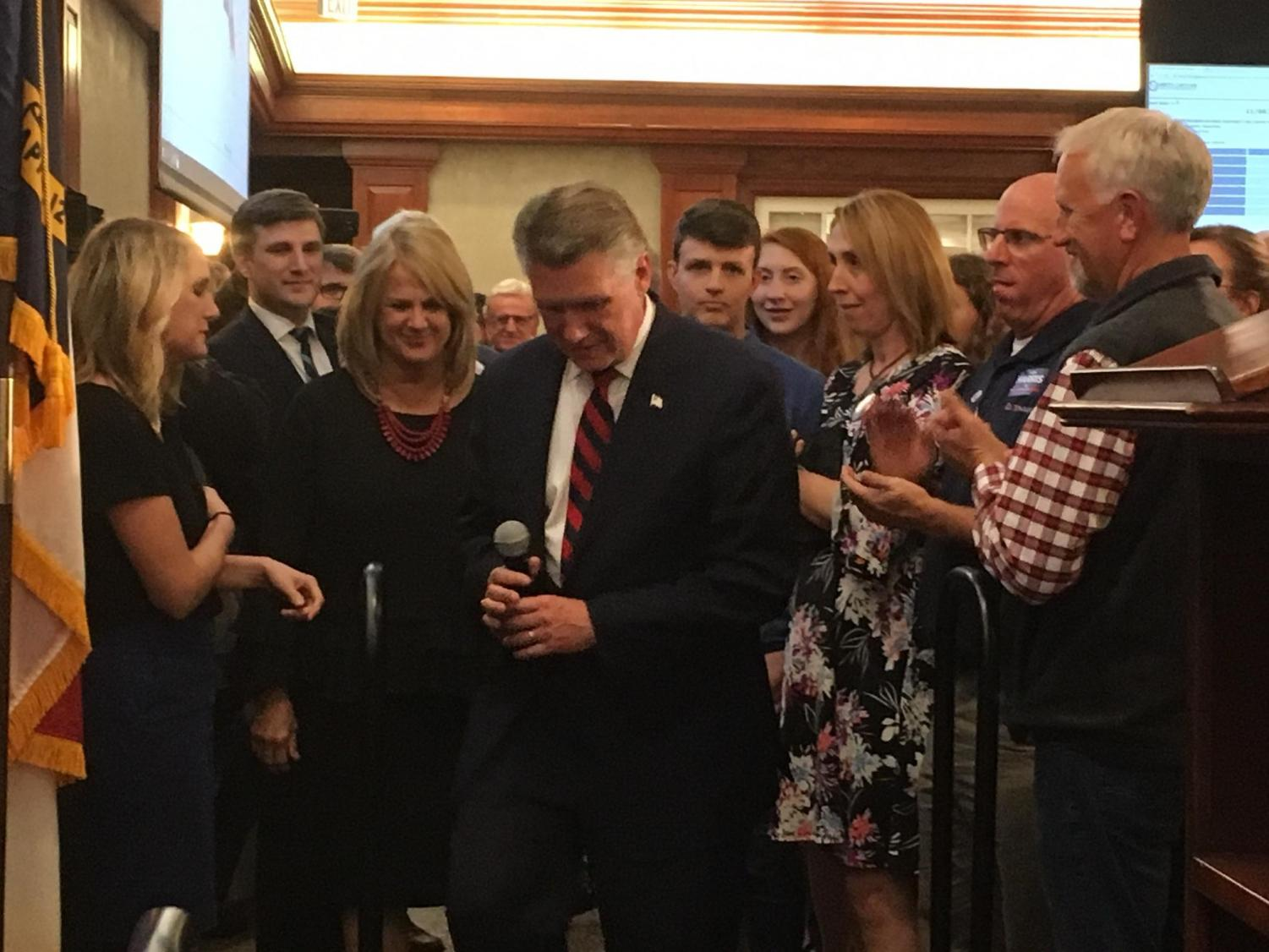 Congressman-elect Mark Harris prepares to take the stage and announce his victory.