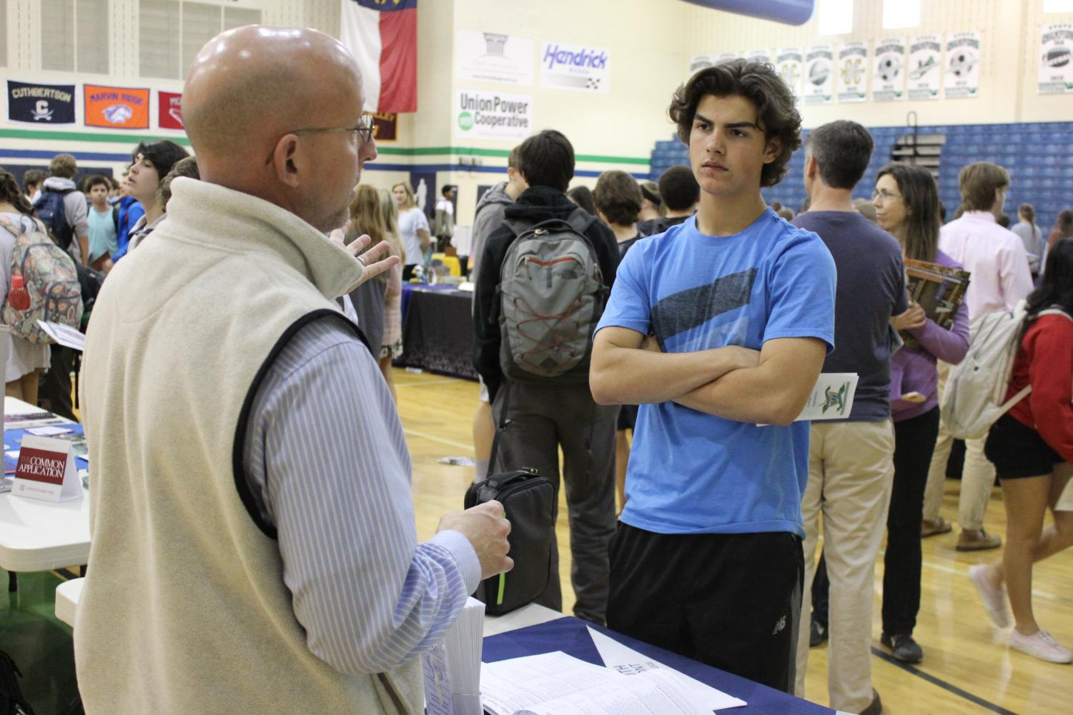 A student discusses his options with a college representative at Weddington's recent college fair.