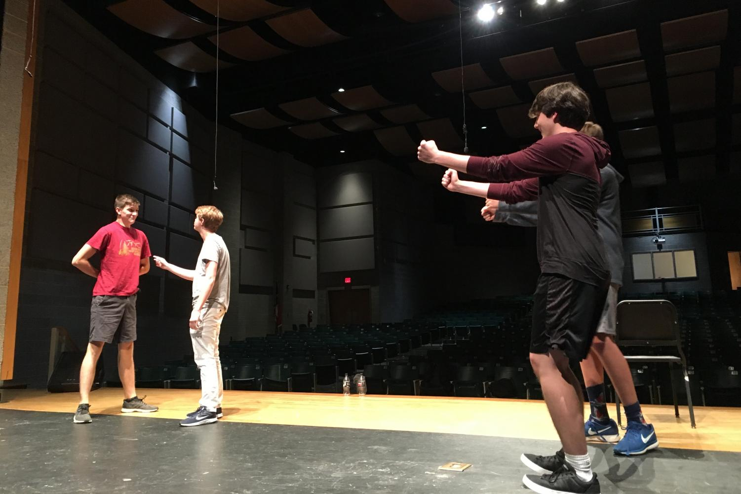 Junior Andrew Page attempts to tell Senior Ayden Fisher why he was