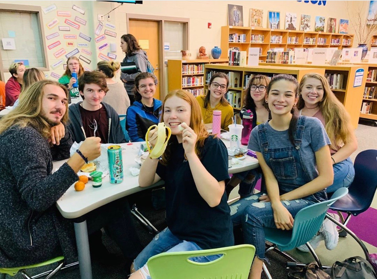 A group of seniors sit in the media center and enjoy their exclusive senior food. The first senior breakfast was held Friday September 20th to great fanfare. Image courtesy the WHS Senior Instagram page.