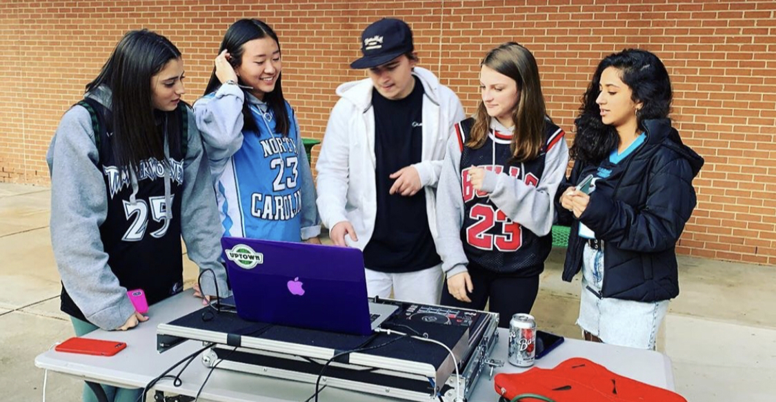 Seniors gather around to learn the ways of a DJ during the Homecoming tailgate this past Friday. Photo from Weddington High School instagram @weddingtonhs