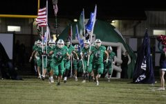 The Weddington Warriors storm the field as they prepare to take on the Parkwood Rebels. The Warriors went on to win the game 45-3.